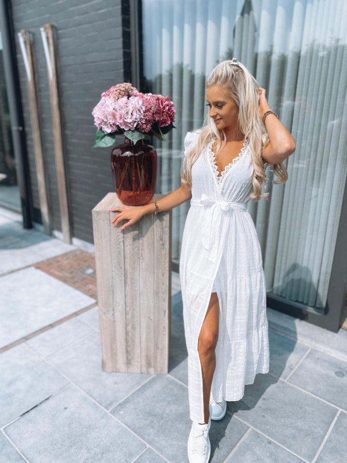 Long white dress.