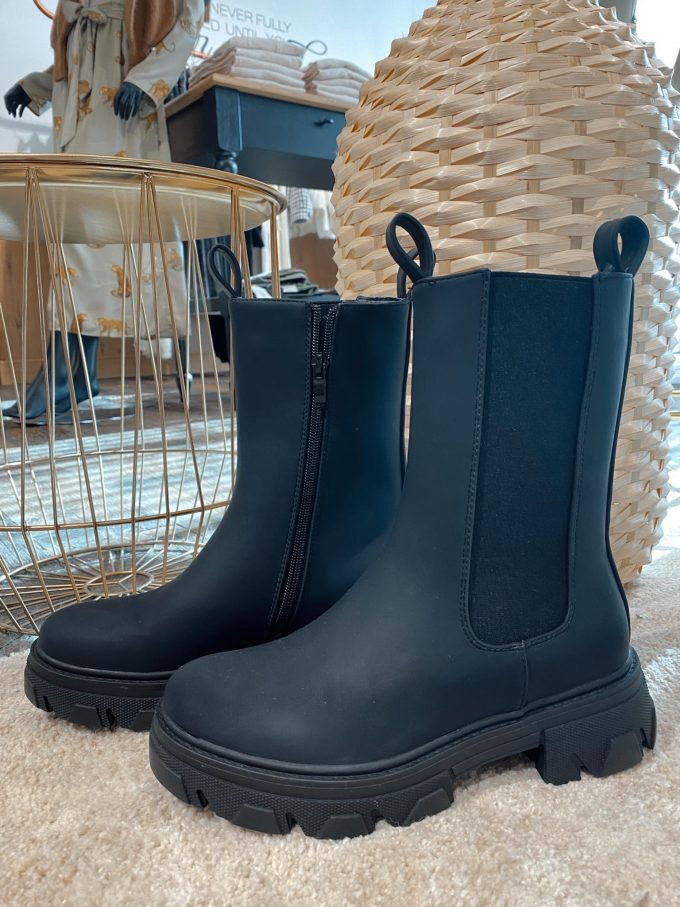 Black leather boots.